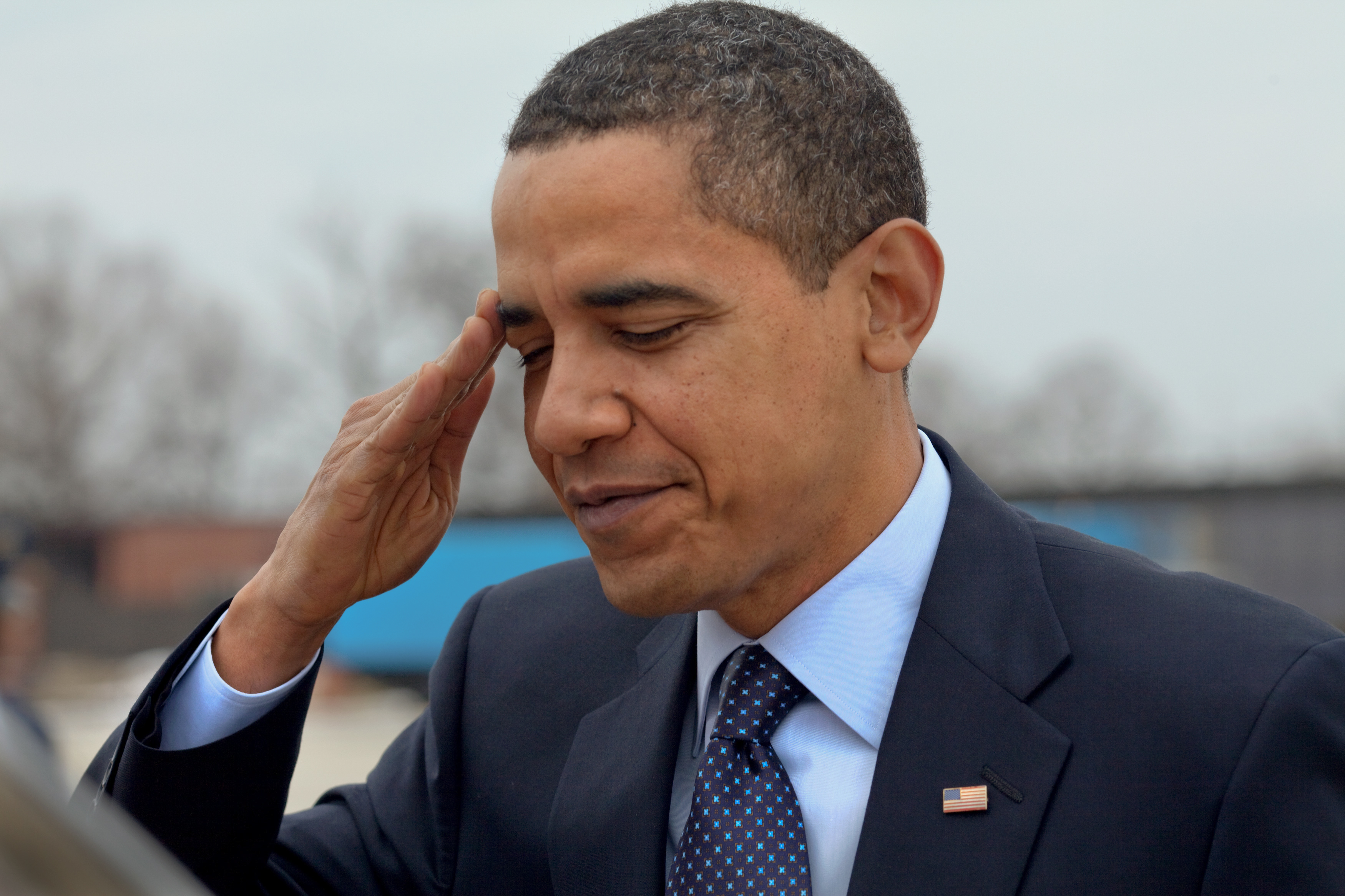 President Barack Obama salutes at Andrews Air Force Base before departing for Columbus, Ohio 3/6/09.
