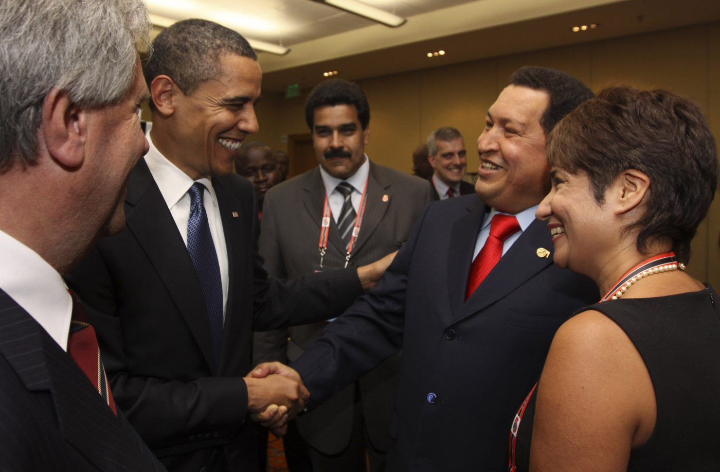 FILE - In this April 17, 2009 file photo, President Barack Obama, left, shakes hands with Venezuela's President Hugo Chavez before the opening session of the 5th Summit of the Americas in Port of Spain, Trinidad and Tobago. Venezuela's Vice President Nicolas Maduro announced on Tuesday, March 5, 2013 that Chavez has died at age 58 after a nearly two-year bout with cancer. (AP Photo/Mariamma Kambon, Summit of the Americas, Pool, File)