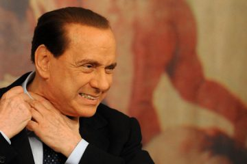 Italian Prime Minister Silvio Berlusconi arrives for a press conference following a ministers' council on July 15, 2009, at Palazzo Chigi in Rome. Italian inflation slowed sharply in June to 0.5 percent on a 12-month comparison, to show the lowest rate of price increases since September 1968, official data showed the same day.  AFP PHOTO / CHRISTOPHE SIMON