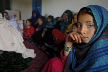 An Afghan girl attends a female engagement team meeting in Balish Kalay Village, Urgun District, Afghanistan, March 27. Women and children attended the meeting with the FET of Paktika Provincial Reconstruction Team to discuss major issues and concerns. The FET gathers vital information from Paktika women, and uses that information to help improve their economic, educational and health issues. For the FET, this meeting was a rare opportunity to learn more about the women of Afghanistan.