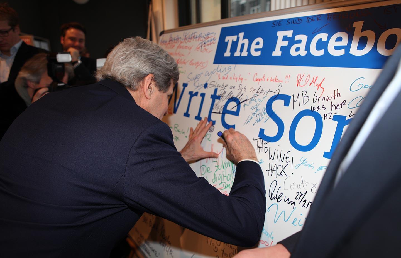 secretary_kerry_signs_a_facebook_wall
