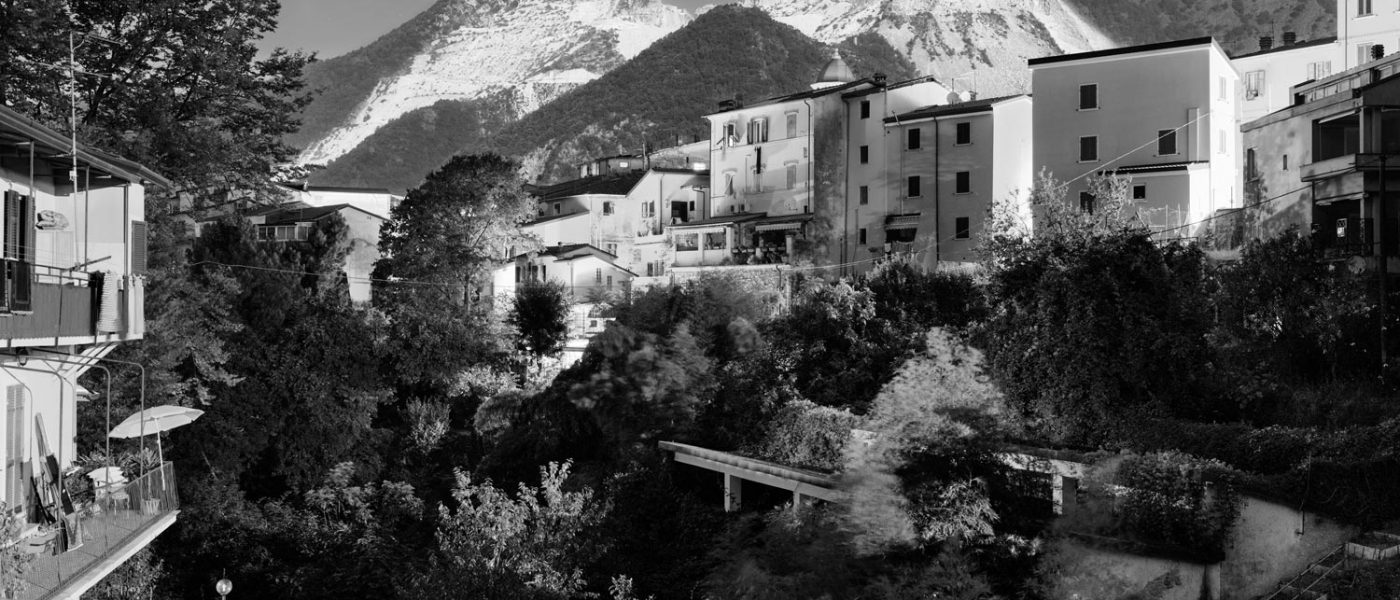 View of Bedizzano miners' village, at the feet of the Colonnata marble basin. There are many villages close to the quarries, once populated by the workers employed in the marble industry. Due to the use of machines, today the number of miners has lowered to few thousands. In the last decade only, the amount of workers has decreased by 30%. While the marble industry is always flourishing, the economy of Carrara's area has been crushing: textile factories, typographies, photo shops, wineries (once related to the quarries) and all sort of businesses have been shutting down in the last 60 years. Photo by Giulia Bianchi